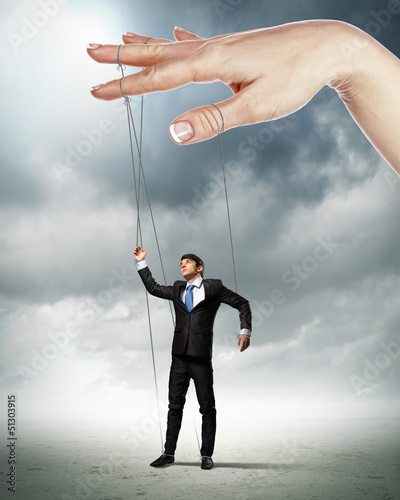 Business man marionette
