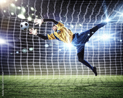 Foto op Aluminium Voetbal Goalkeeper catches the ball