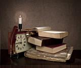 vintage books, pen, watch and candle