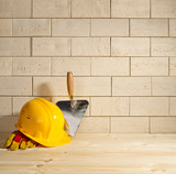 brick background, trowel and helmet