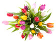 Colorful tulips in a glass vase isolated on a white background