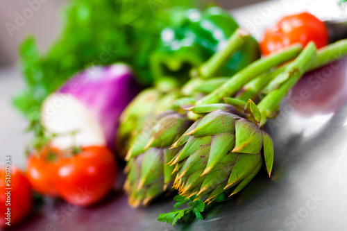 A selection of vegetables on a kitchen's table