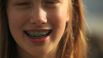 Portrait of a young girl with braces