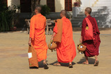 Buddhist monks walking in the courtyard of Wat Ounalom, Phnom Pe