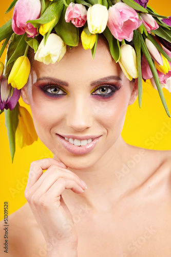 woman portrait with wreath from flowers on head over spring  bac