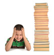 Child with headache near tower of books