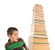 Child surprised to see tower of books isolated on white