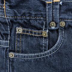 Jeans pocket. Fragment of blue jeans.