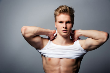 Young handsome blond man wearing t-shirt
