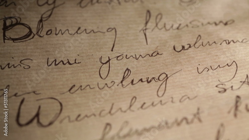 Abstract inscriptions on brown vintage paper background.