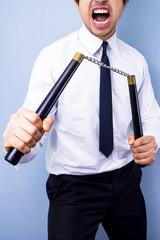 Businessman with nunchaku nunchucks