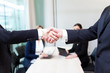 Business people shaking hands in the office, finishing a meeting