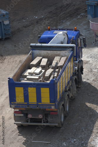 Truck carrying concrete blocks