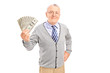 Smiling senior gentleman holding money