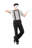 Full length portrait of a male mime artist gesturing with hand