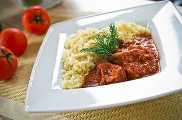 Tomato curry with couscous