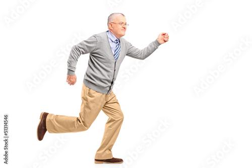 Full length portrait of a mature gentleman running