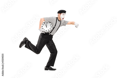 Full length portrait of a mime artist holding a clock and runnin