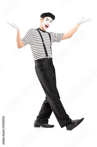Full length portrait of a male mime dancer gesturing with hands