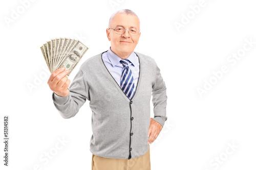 Smiling senior gentleman holding money
