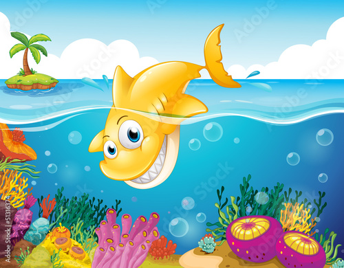 A yellow shark diving into the sea