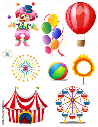 A clown playing balls with different circus stuffs