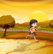 A girl running along the field
