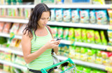 A woman reads SMS in supermarkets