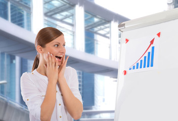 Happy businesswoman with progress chart, office building