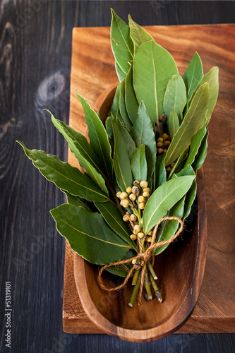 Bay leaf on a wooden board