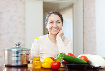 Smiling mature woman with  vegetables