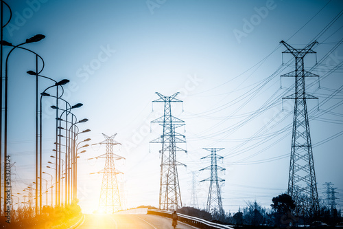 High voltage towers at sunset - 51320324