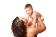 Young mother holding her son in her arms on a white background
