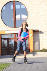 Girl roller skating to the school