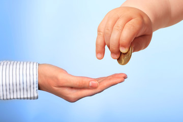 Baby's hand and coin.