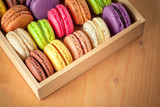 traditional french colorful macarons in a wooden box poster