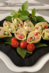 Sea shells pasta stuffed with vegetables and ham
