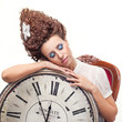 Portrait of a beautiful girl with a big English clock