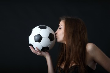 sexy woman in lingerie kissing a classic soccer ball