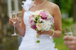 Bride is holding a wedding bouquet