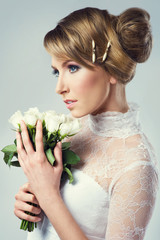 beautiful bride holding white flowers