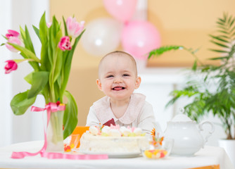 joyful kid girl at birthday table