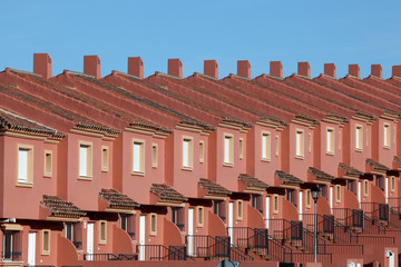 Row of red residential houses in a urbanization in Spain