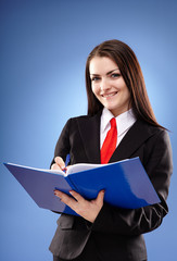 Happy businesswoman holding a notebook