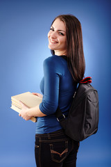 Student girl with backpack and books