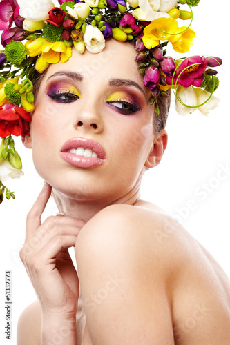 Woman with hairstyle and freesia flower. Isolated.