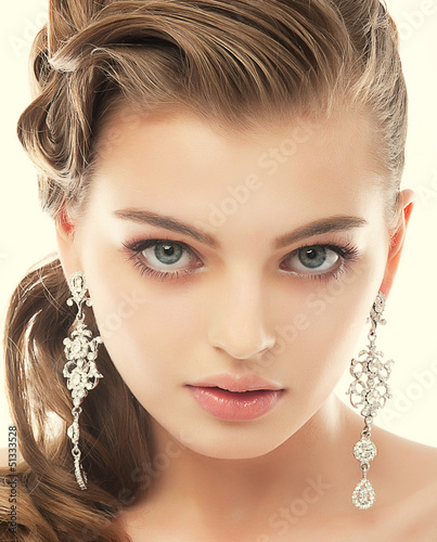 Jewelry. Gorgeous Exquisite Woman with Earrings. Refinement
