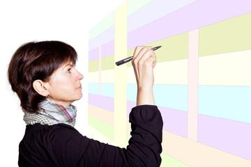 Frau mit Stift am Wandplaner