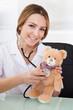 Female Doctor Examining Teddy Bear