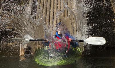 Kayaker making a splash